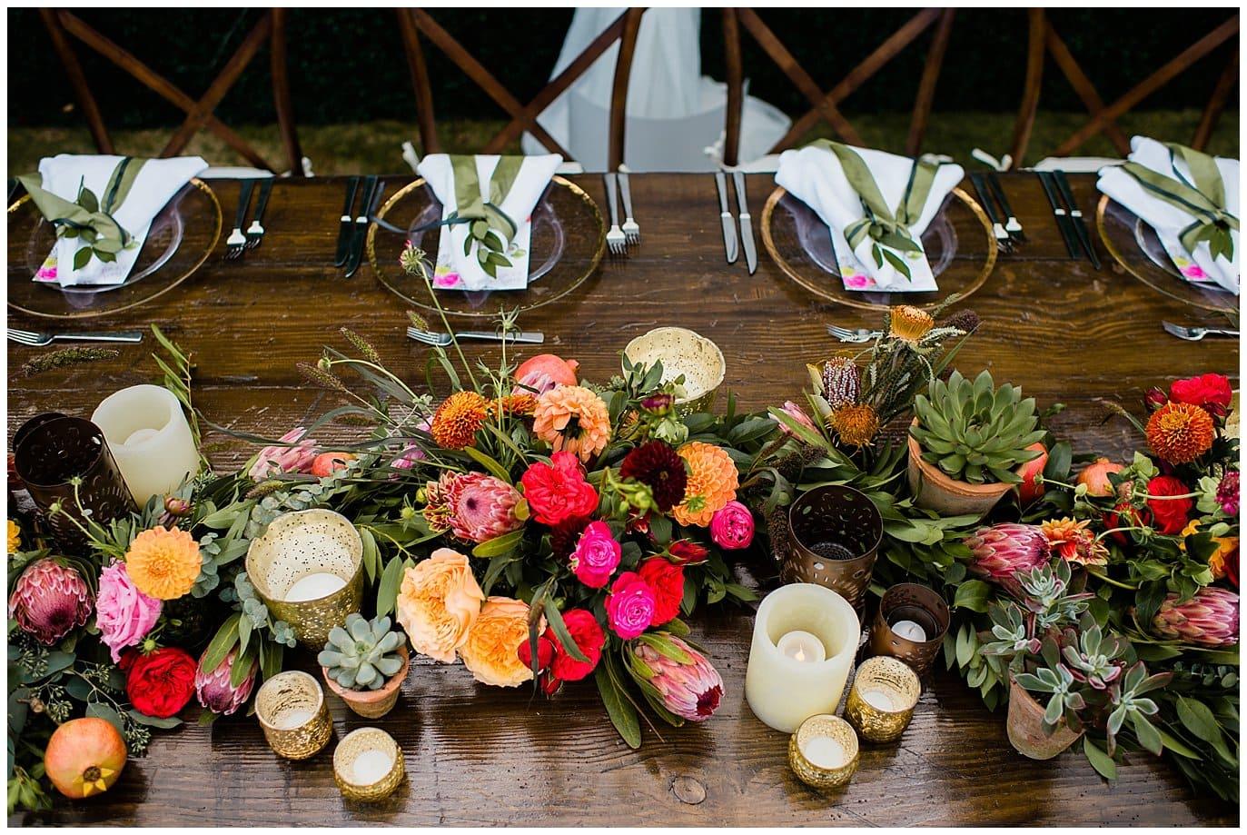 colorful head table Rancho Valencia reception photo