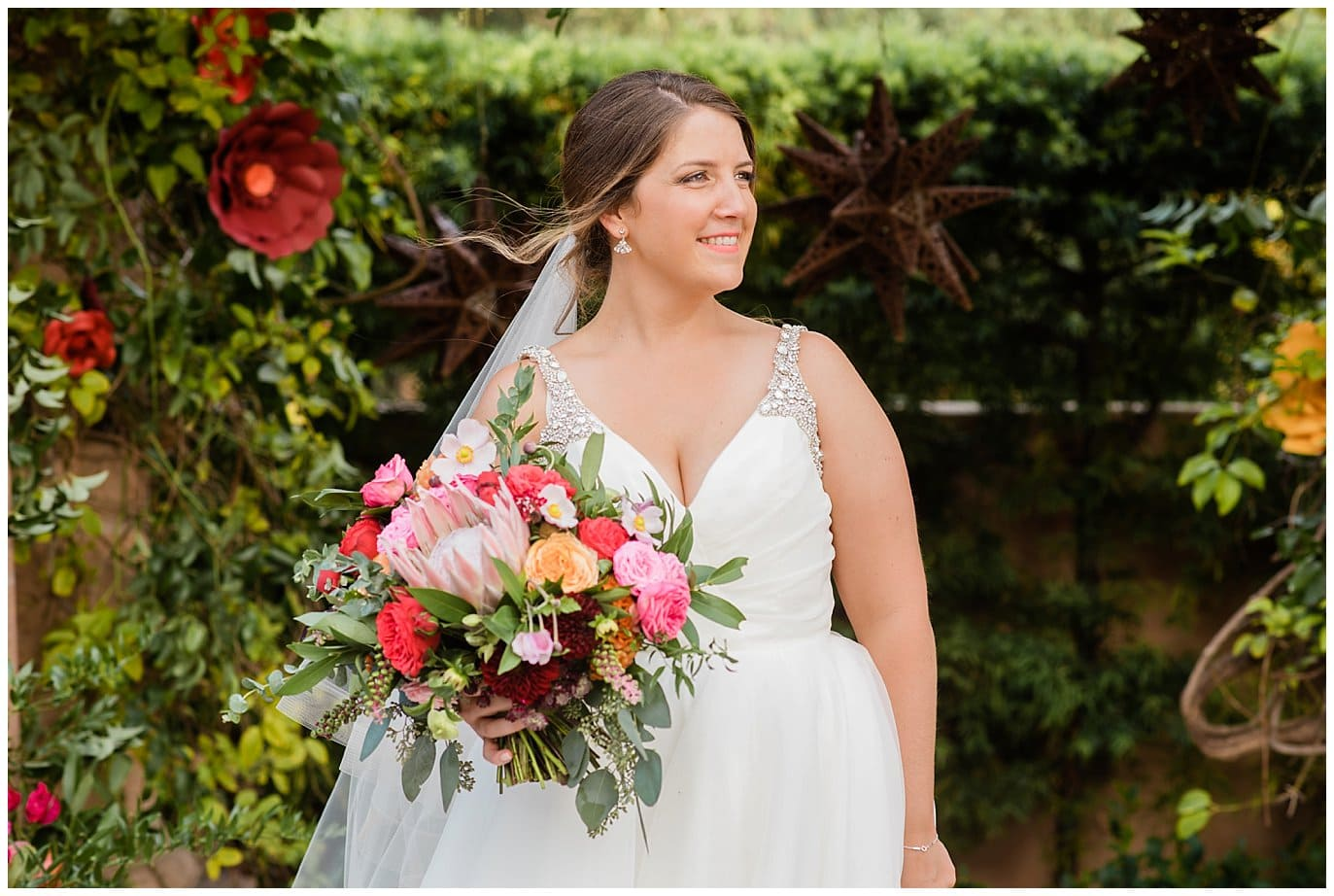 california bride with colorful wedding bouquet and hayley paige dress