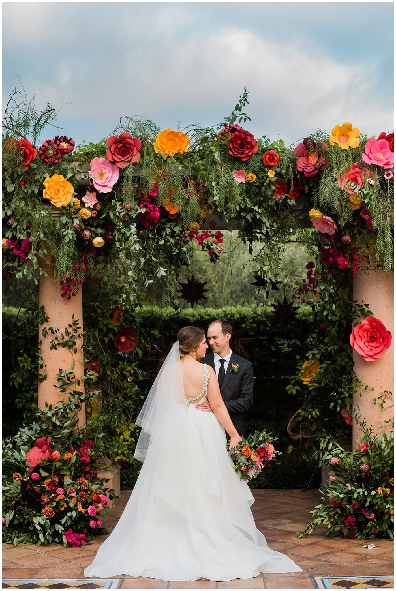 colorful paper flower wedding alter photo