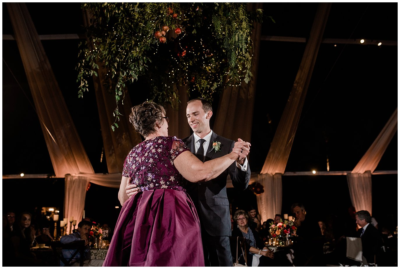 mother son open air reception tent dancing photo
