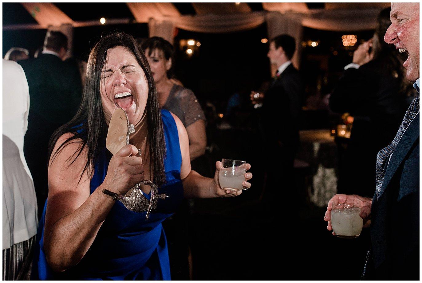 crazy wedding guest dancing photo