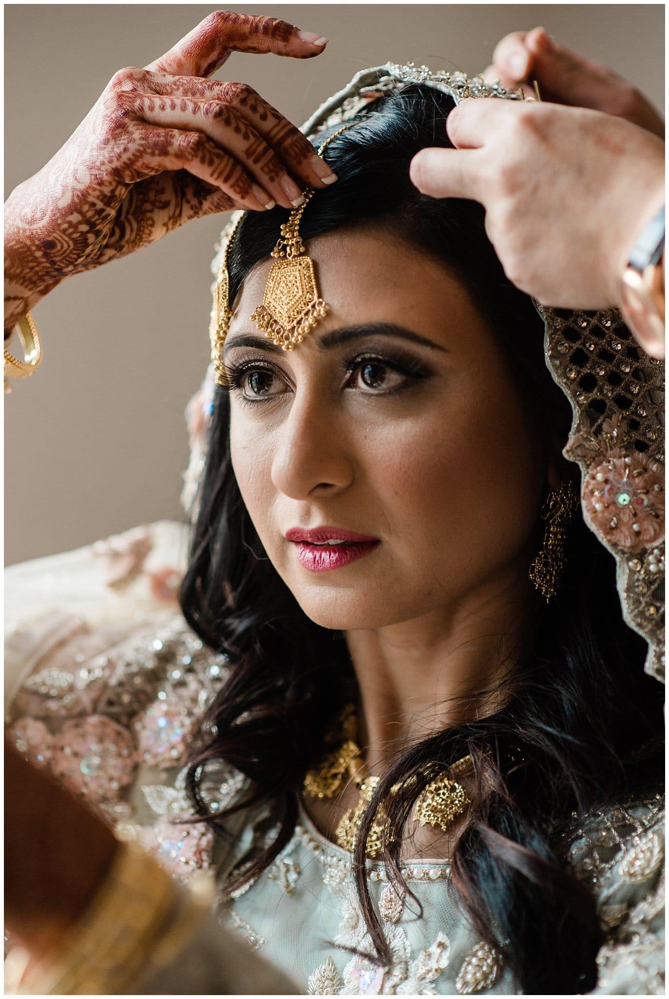bride putting on dupatta before wedding Nikah photo