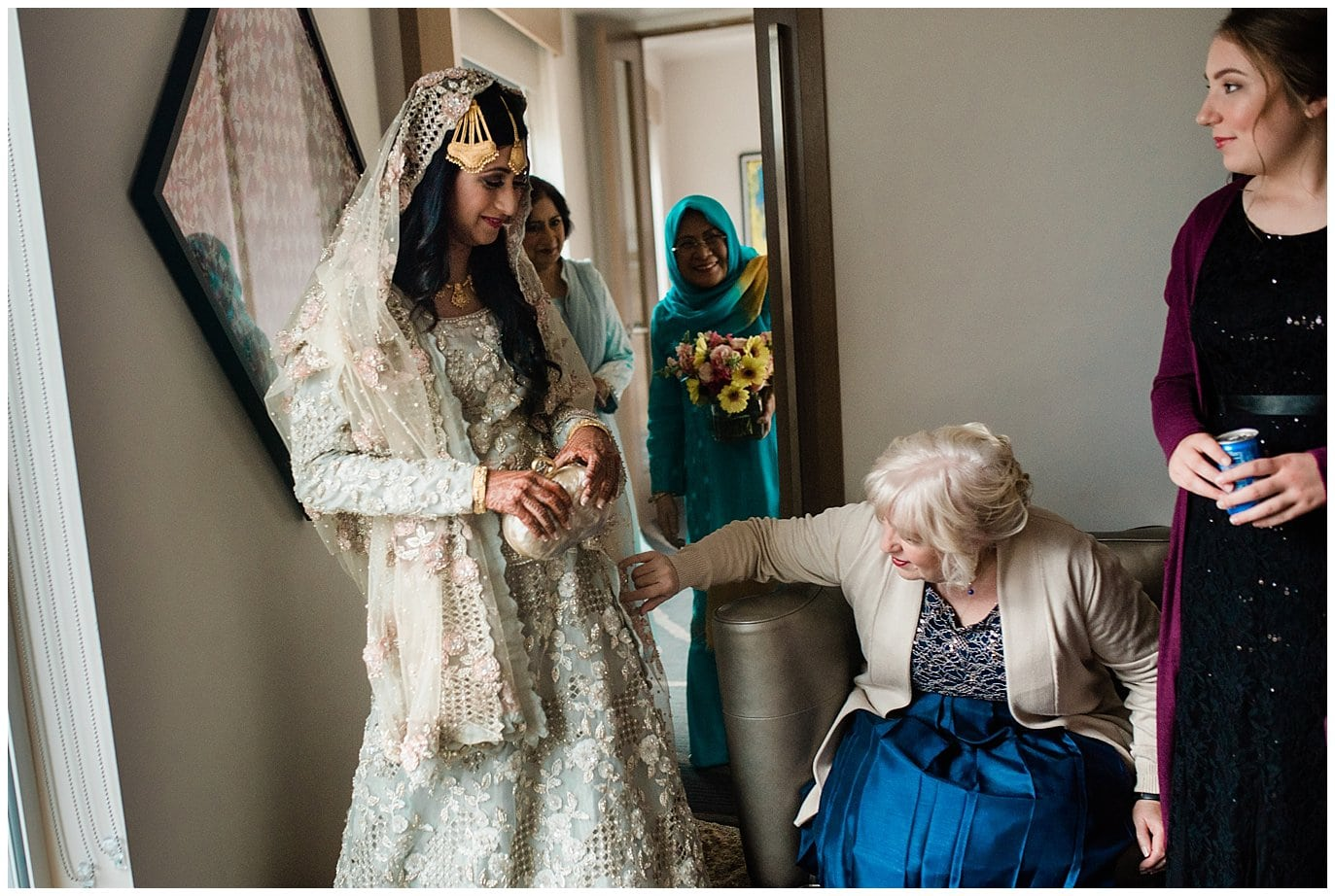 bride showing off pale blue wedding dress before Nikah ceremony photo