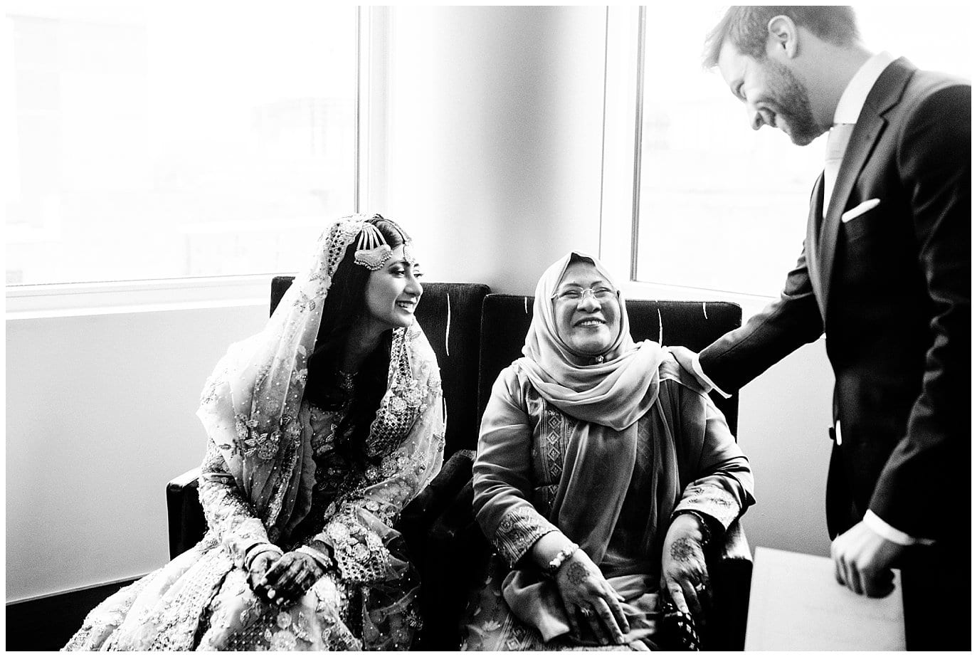 groom greeting bride and bride's mother at Denver Nikah Ceremony photo