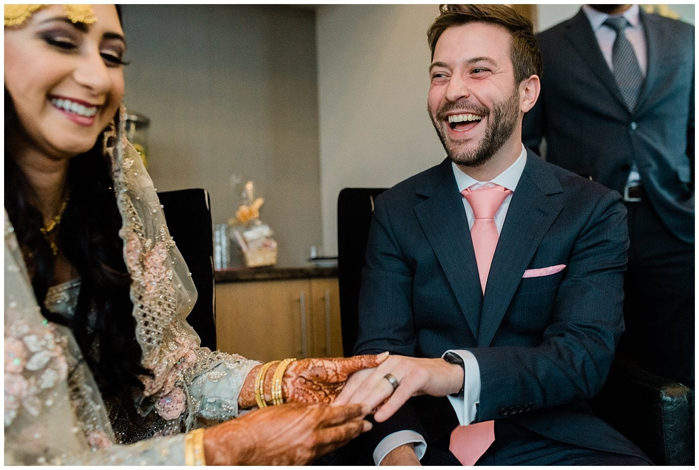 bride and groom exchange rings at Denver Nikah Ceremony Photo