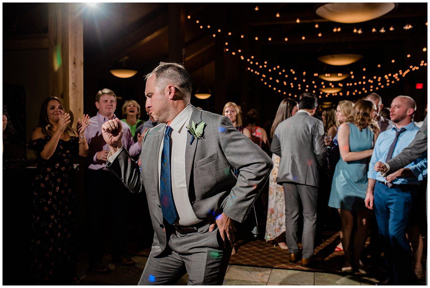 break dancing at Arapahoe Basin Black Mountain Lodge Wedding by Denver Wedding Photographer Jennie Crate