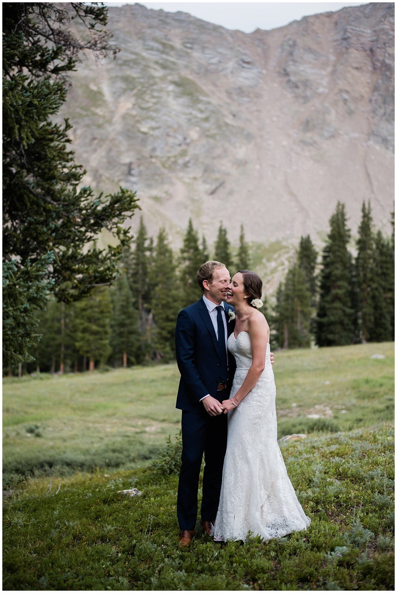 Bride and groom laughing at Arapahoe Basin Black Mountain Lodge Wedding by Arapahoe Basin Wedding Photographer Jennie Crate