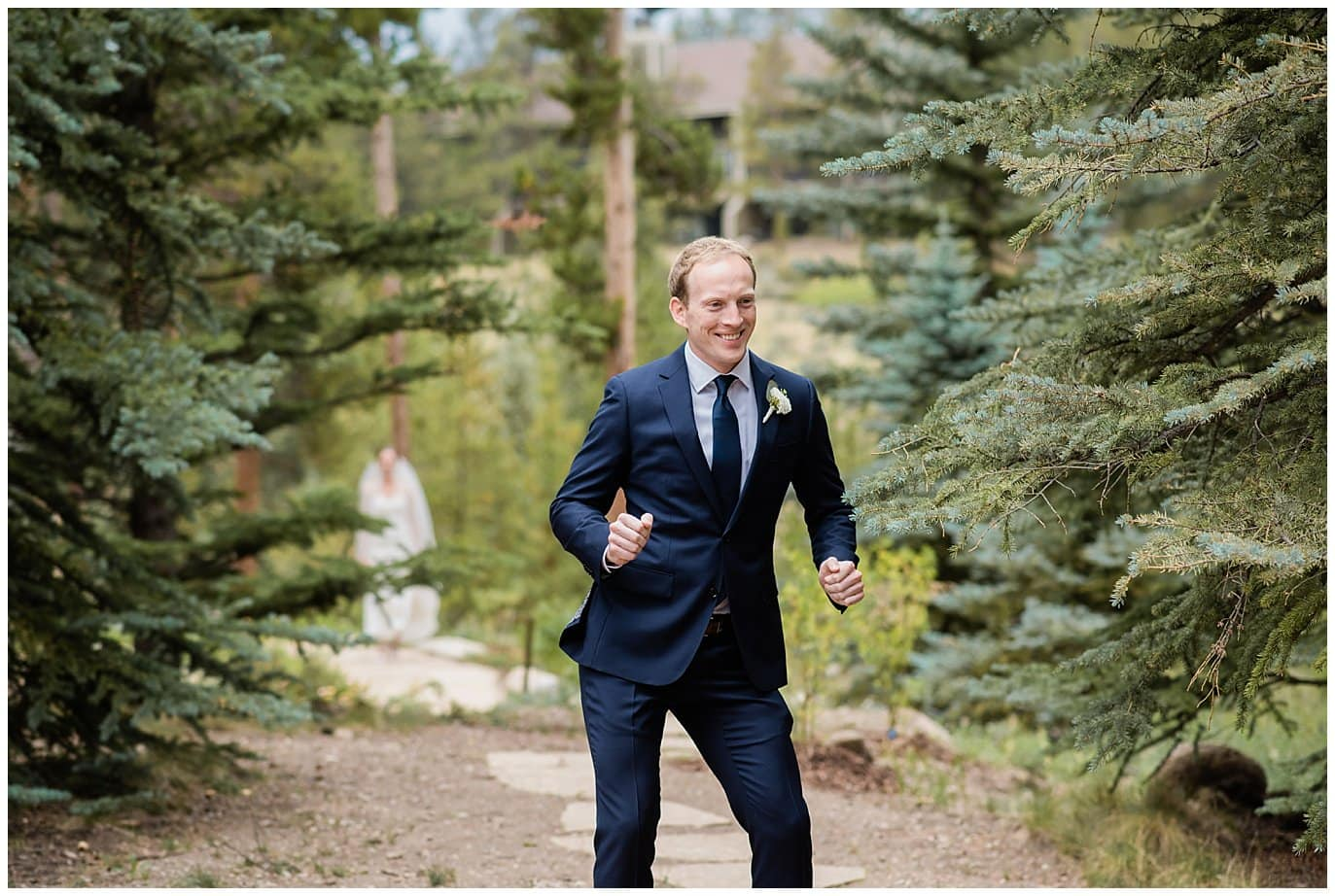 groom dancing during first look at Arapahoe Basin Black Mountain Lodge Wedding by Silverthorne Wedding Photographer Jennie Crate