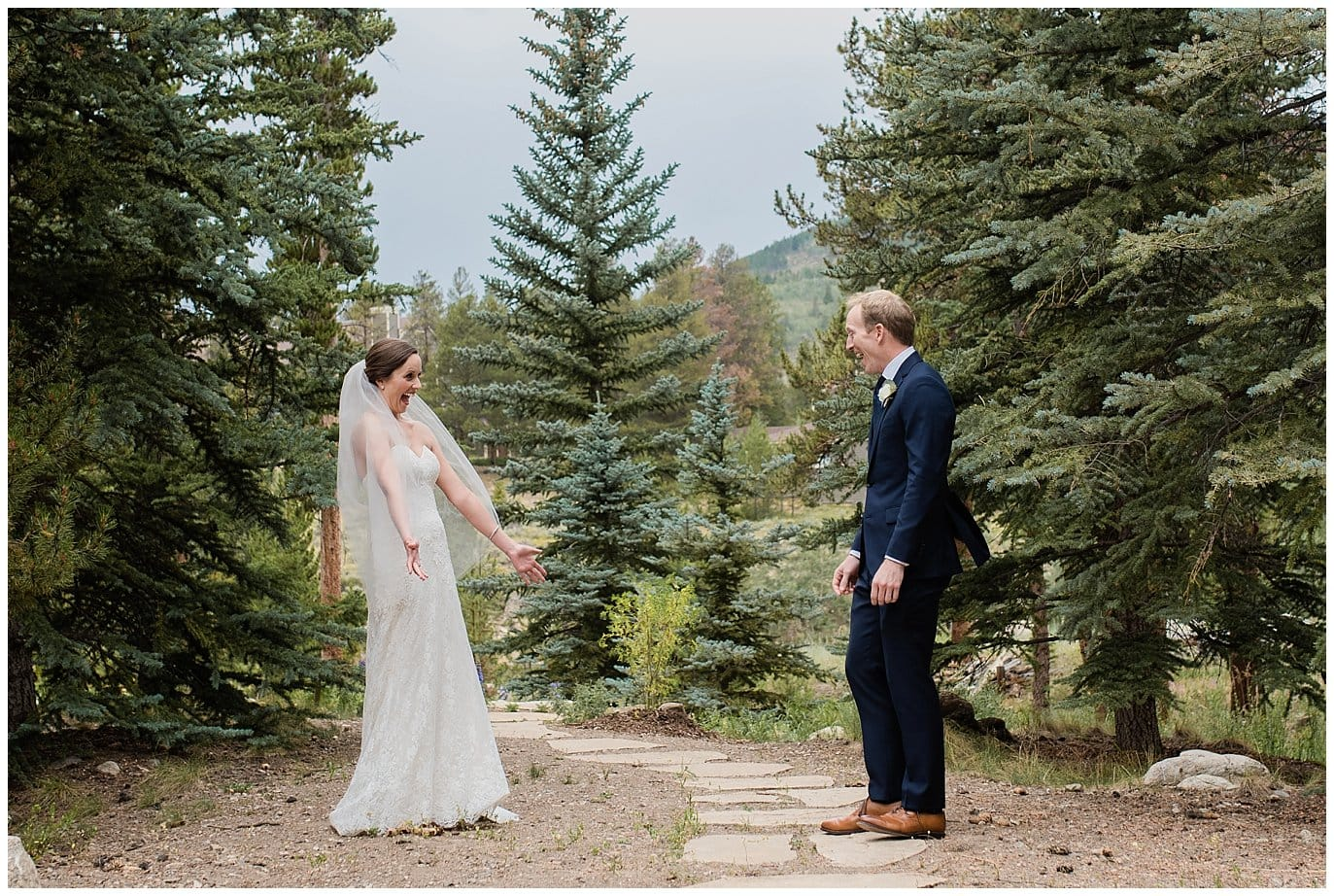excited first look between bride and groom at Arapahoe Basin Black Mountain Lodge Wedding by Breckenridge Wedding Photographer Jennie Crate