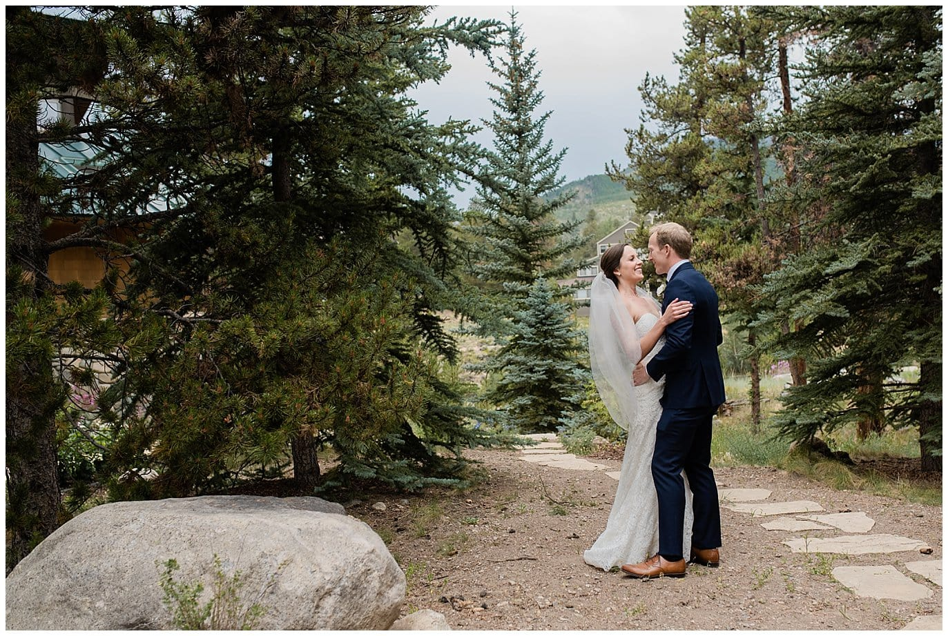 first look in colorado evergreens at Arapahoe Basin Black Mountain Lodge Wedding by Evergreen Wedding Photographer Jennie Crate