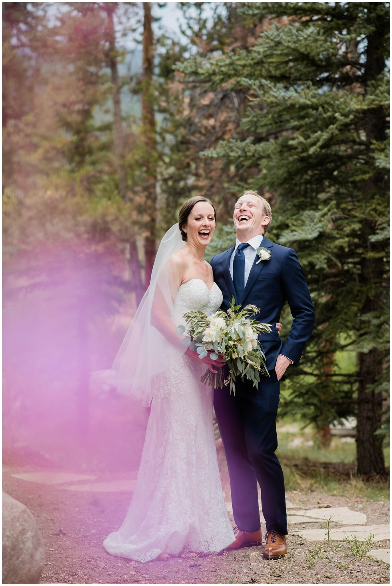 laughing bride and groom at Arapahoe Basin Black Mountain Lodge Wedding by Colorado Wedding Photographer Jennie Crate