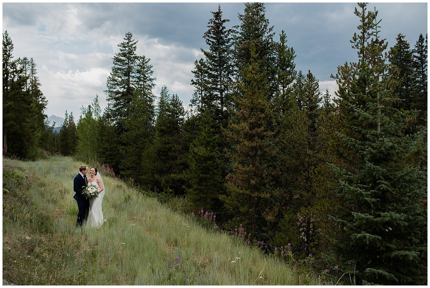 bride and groom in Colorado forest at Arapahoe Basin Black Mountain Lodge Wedding by Arapahoe Basin Wedding Photographer Jennie Crate