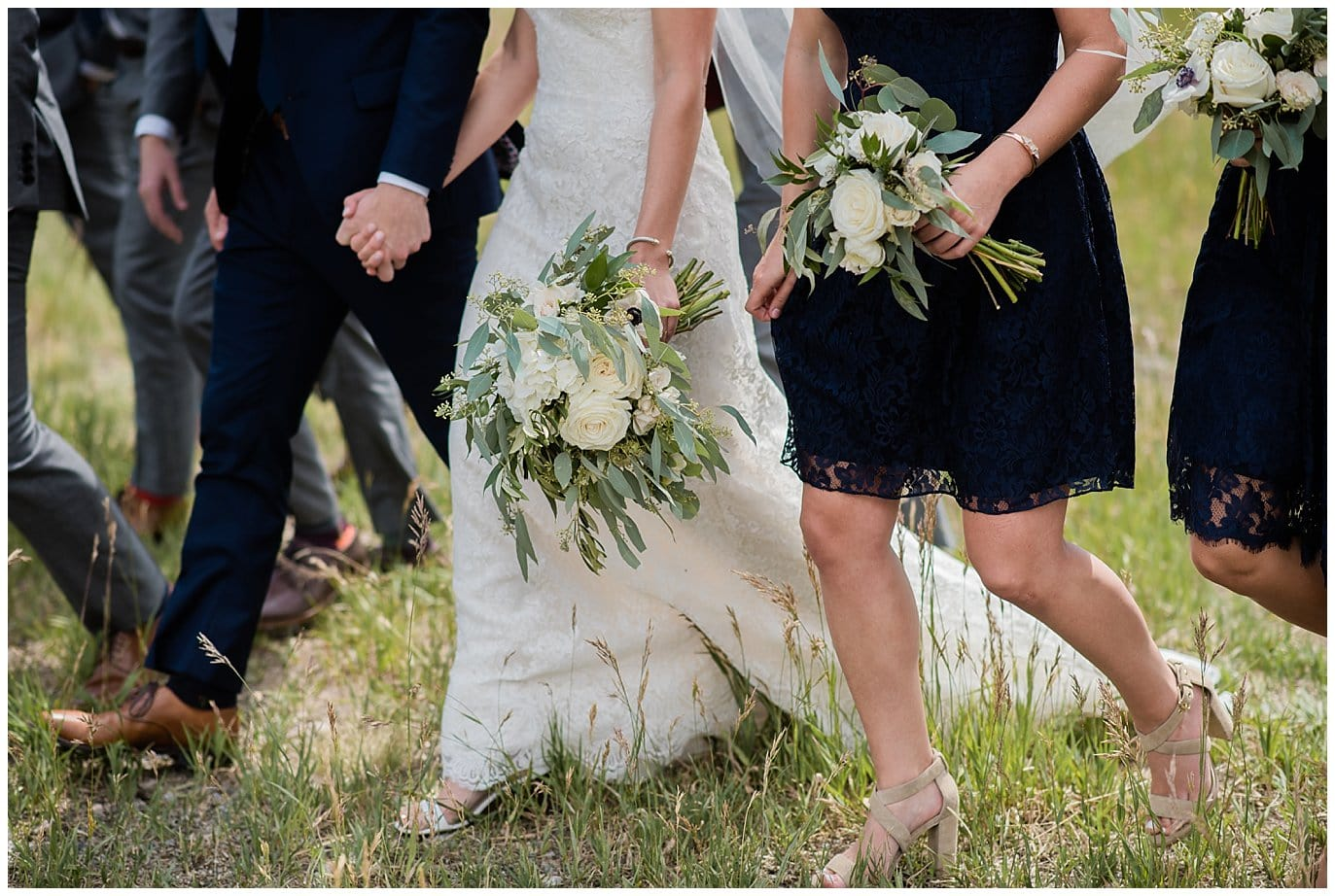 ivory and green wedding flowers and navy bridesmaid dresses at Arapahoe Basin Black Mountain Lodge Wedding by Colorado Wedding Photographer Jennie Crate