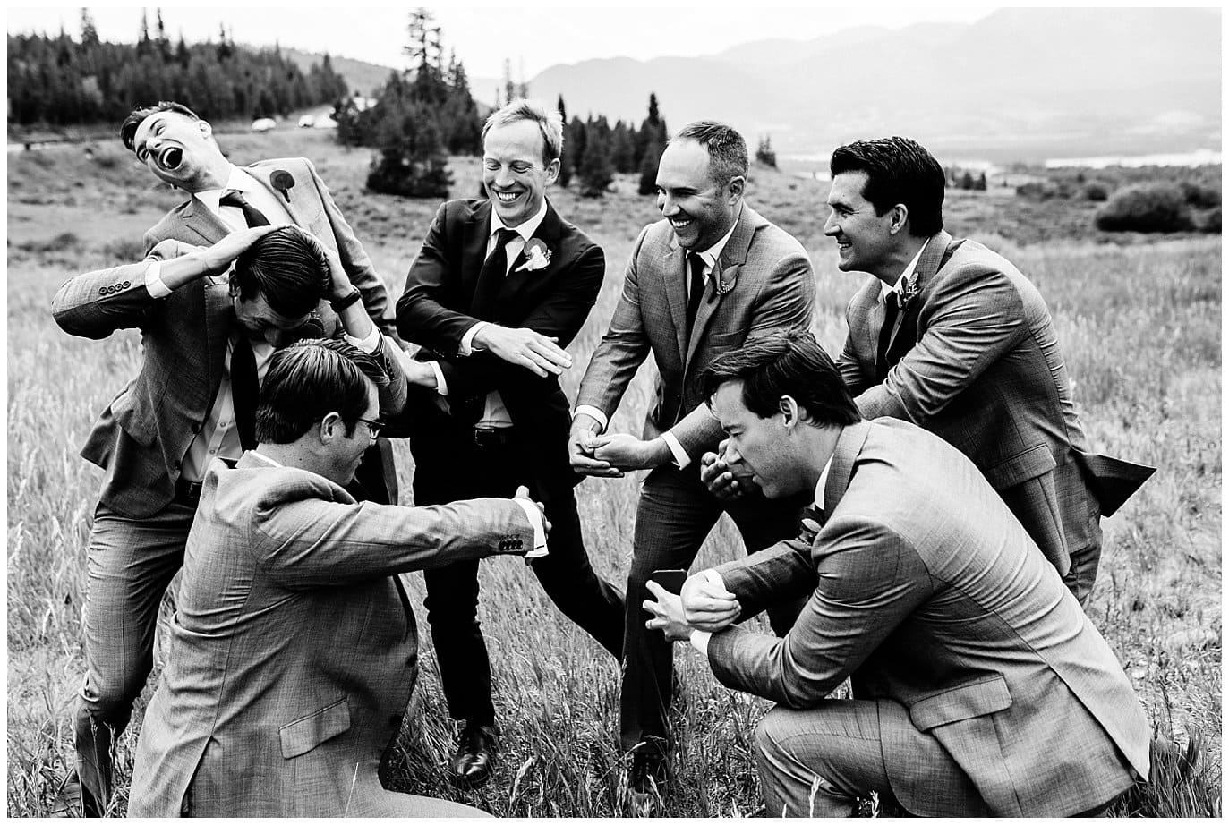 groom and groomsmen playing the drums at Arapahoe Basin Black Mountain Lodge Wedding by Arapahoe Basin Wedding Photographer Jennie Crate