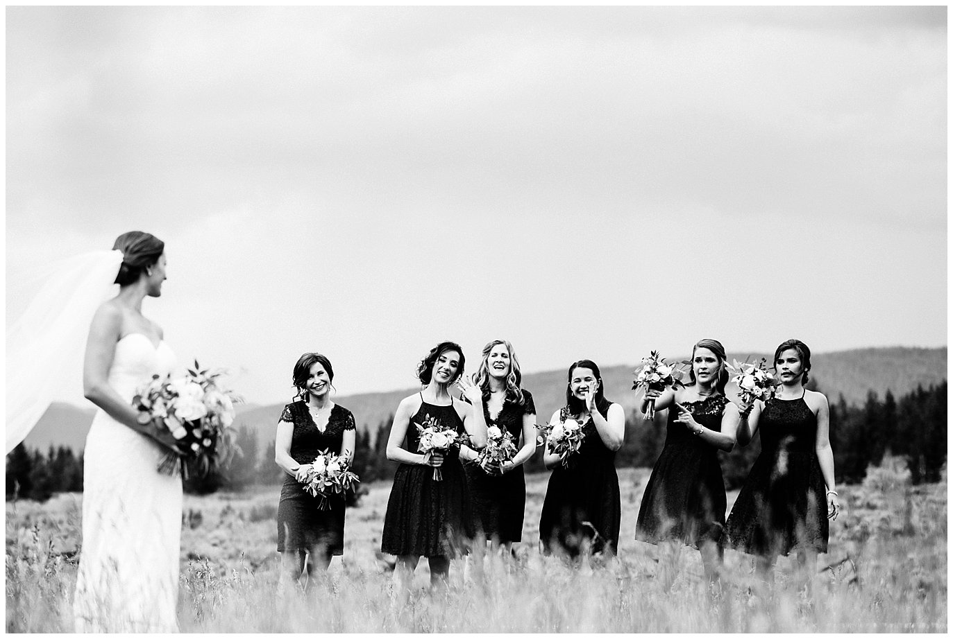 bride and bridesmaids in fields at Arapahoe Basin Black Mountain Lodge Wedding by Dillon Wedding Photographer Jennie Crate