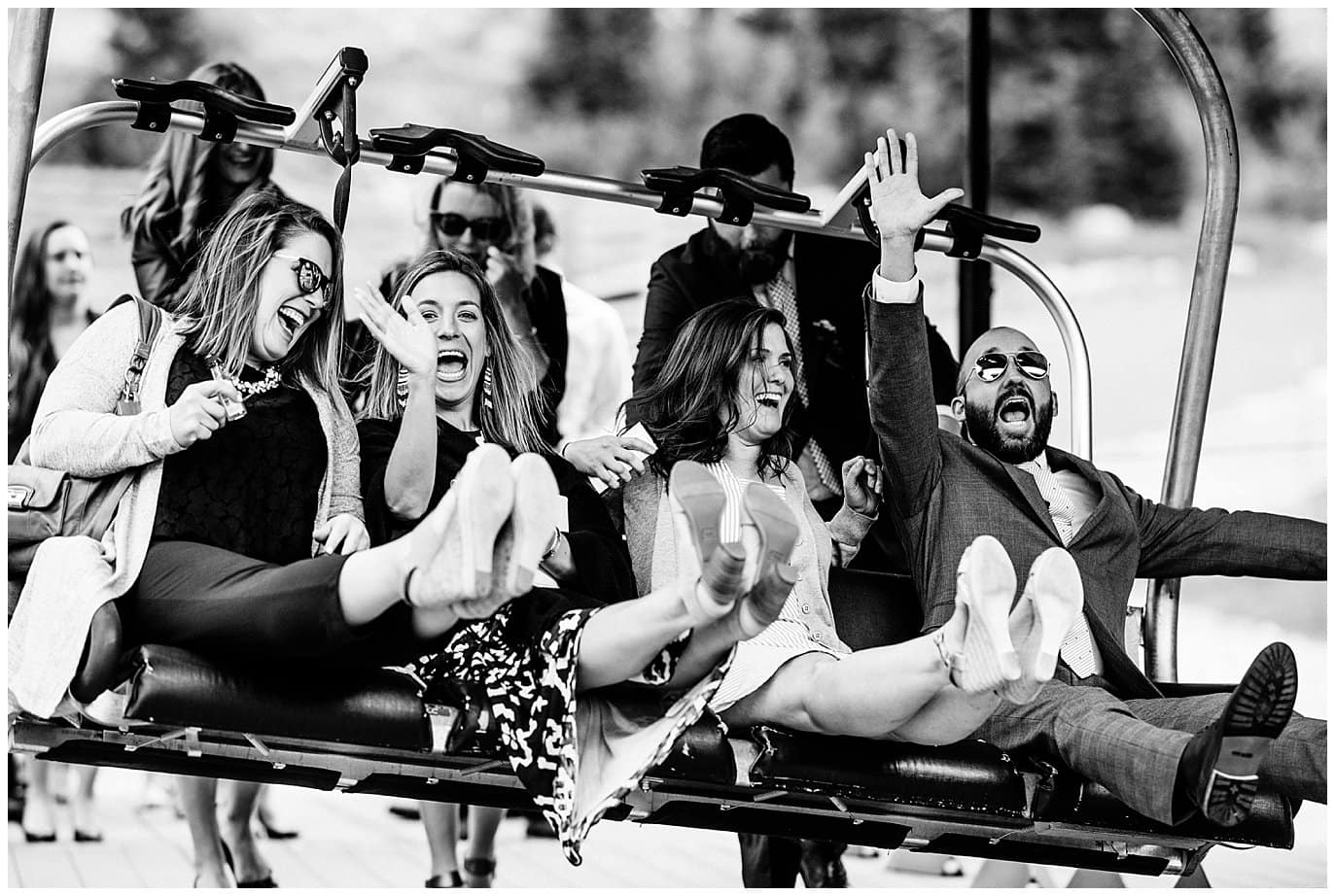 guests boarding chair lifts at Arapahoe Basin Black Mountain Lodge Wedding by Dillon Wedding Photographer Jennie Crate