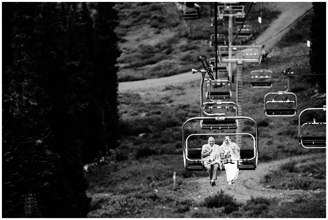 bride and father riding to ceremony site down chair lift at Arapahoe Basin Black Mountain Lodge Wedding by Denver Wedding Photographer Jennie Crate
