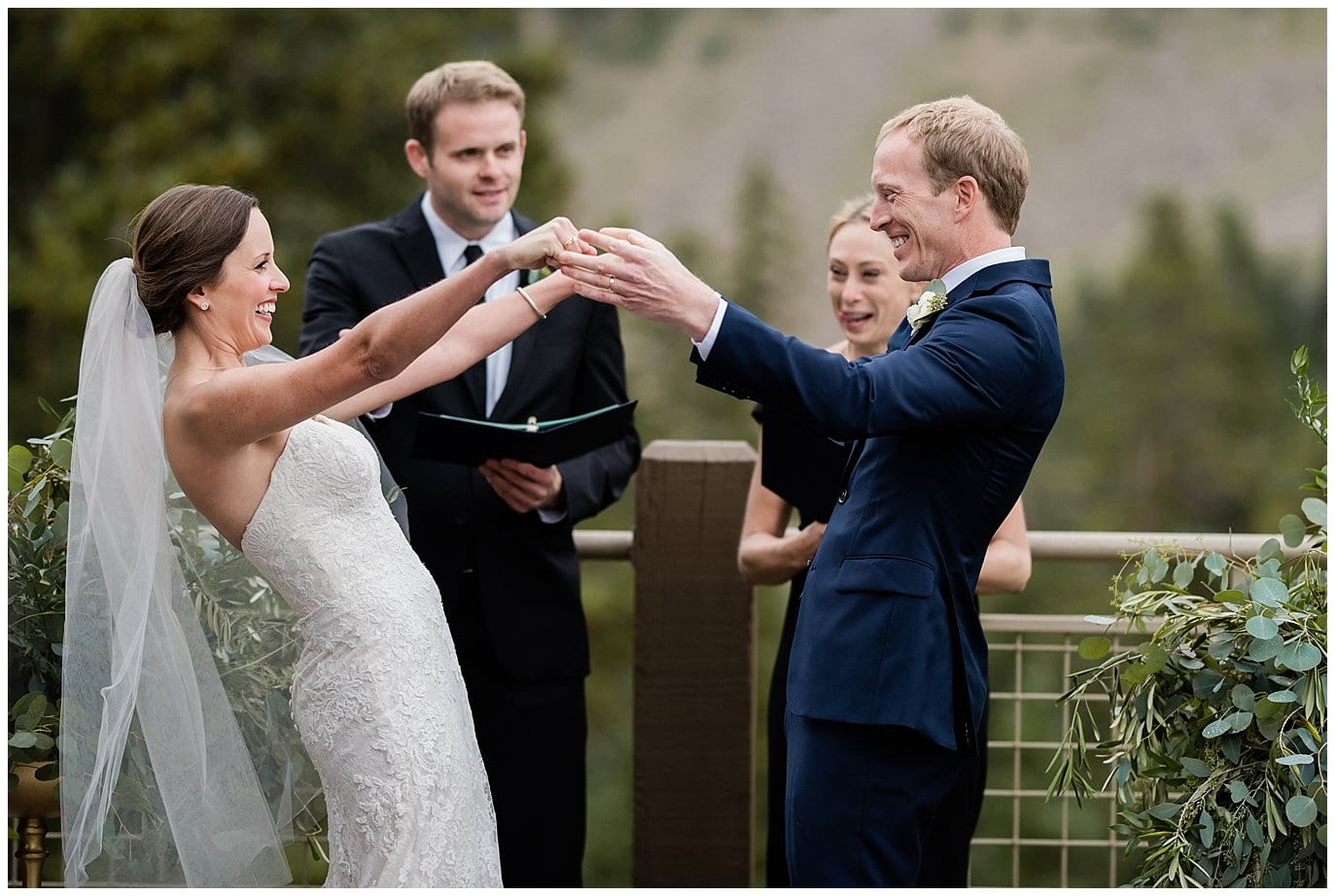 excited couple at wedding ceremony at Arapahoe Basin Black Mountain Lodge Wedding by Arapahoe Basin Wedding Photographer Jennie Crate