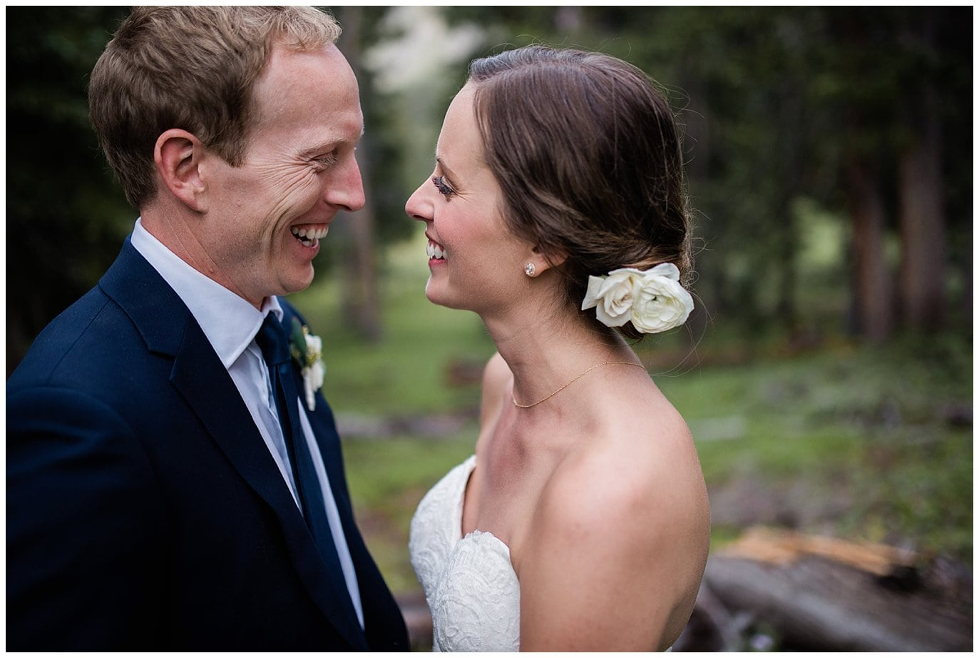 white flowers in bride's hair at Arapahoe Basin Black Mountain Lodge Wedding by Colorado Wedding Photographer Jennie Crate
