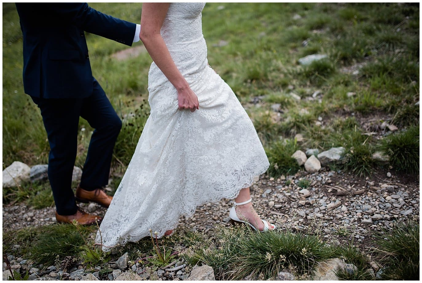 bride in lace dress and heels walking at Arapahoe Basin Black Mountain Lodge Wedding by Dillon Wedding Photographer Jennie Crate