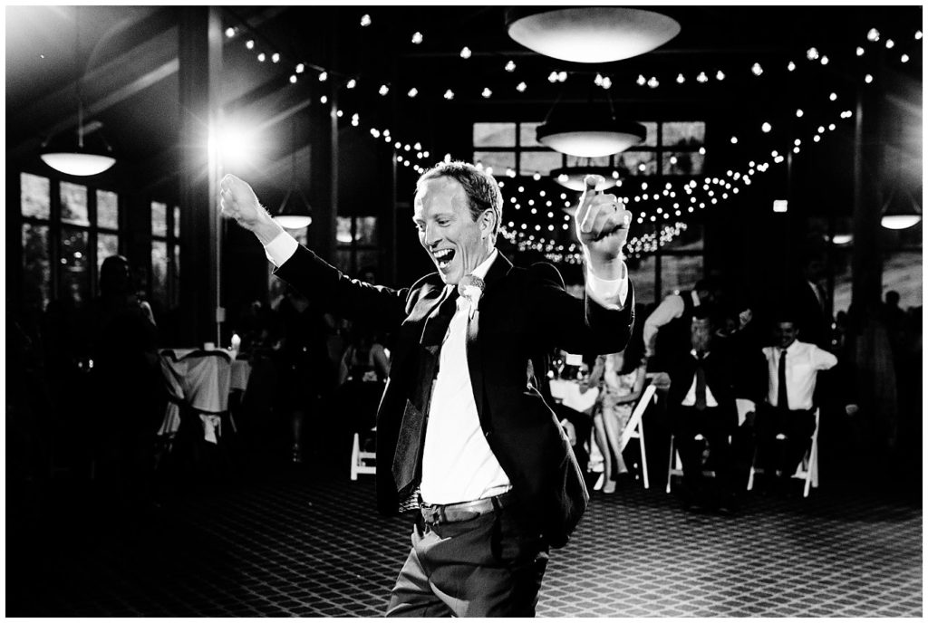 groom dancing at Black Mountain Lodge reception in Colorado photo