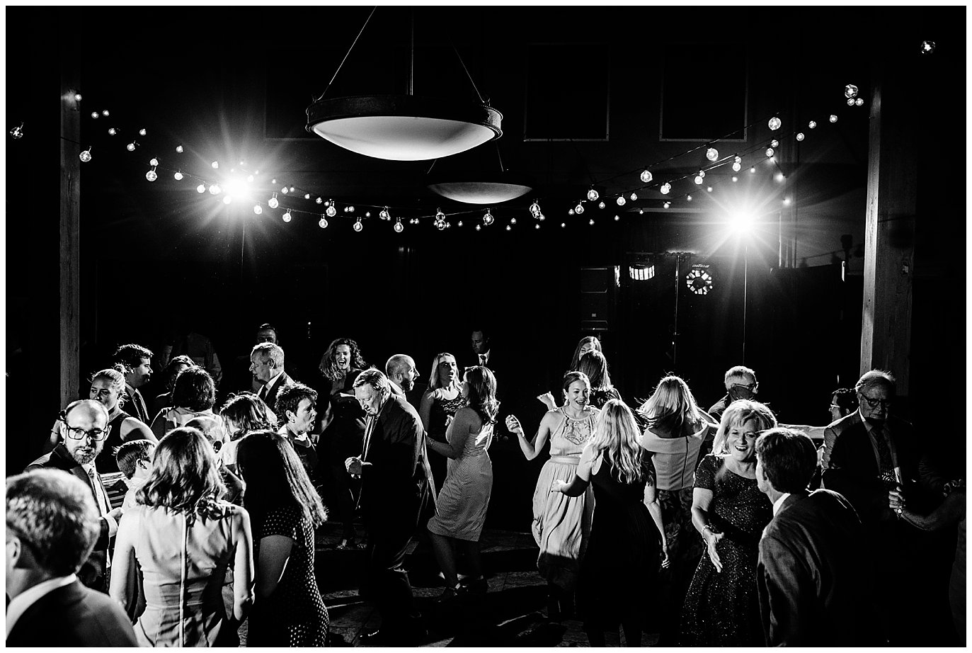 Group dance party at Arapahoe Basin Black Mountain Lodge Wedding by Dillon Wedding Photographer Jennie Crate
