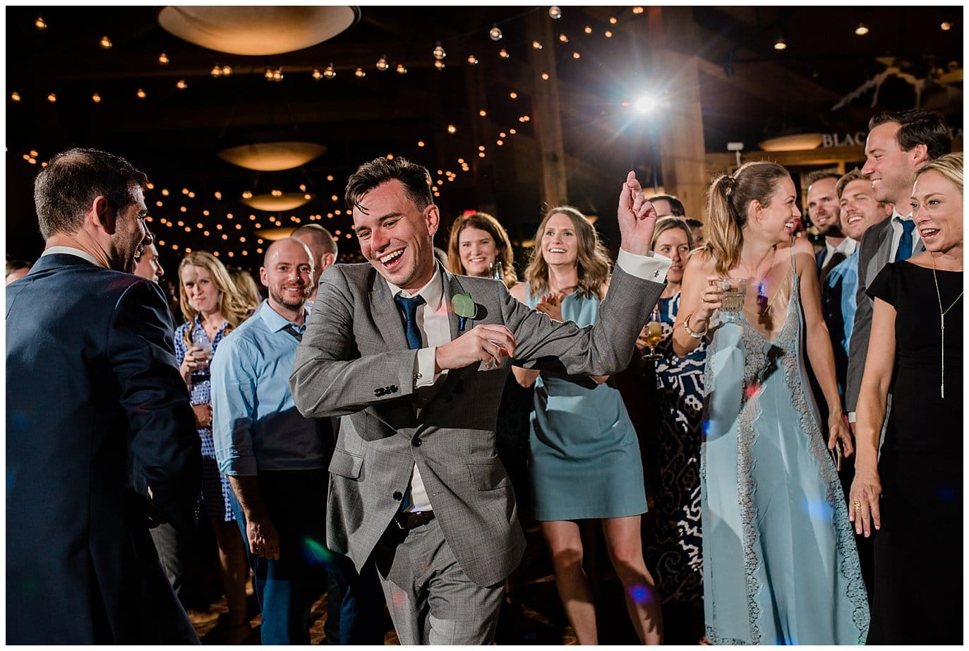 Guests dancing at Arapahoe Basin Black Mountain Lodge Wedding by Dillon Wedding Photographer Jennie Crate