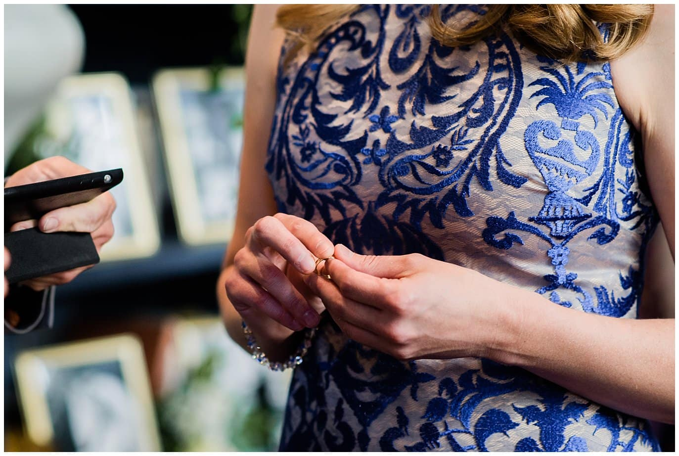 bride in blue dress with wedding ring photo