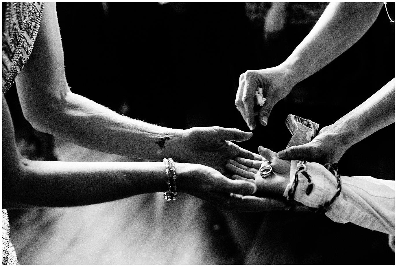ring bearer passing rings to bride photo