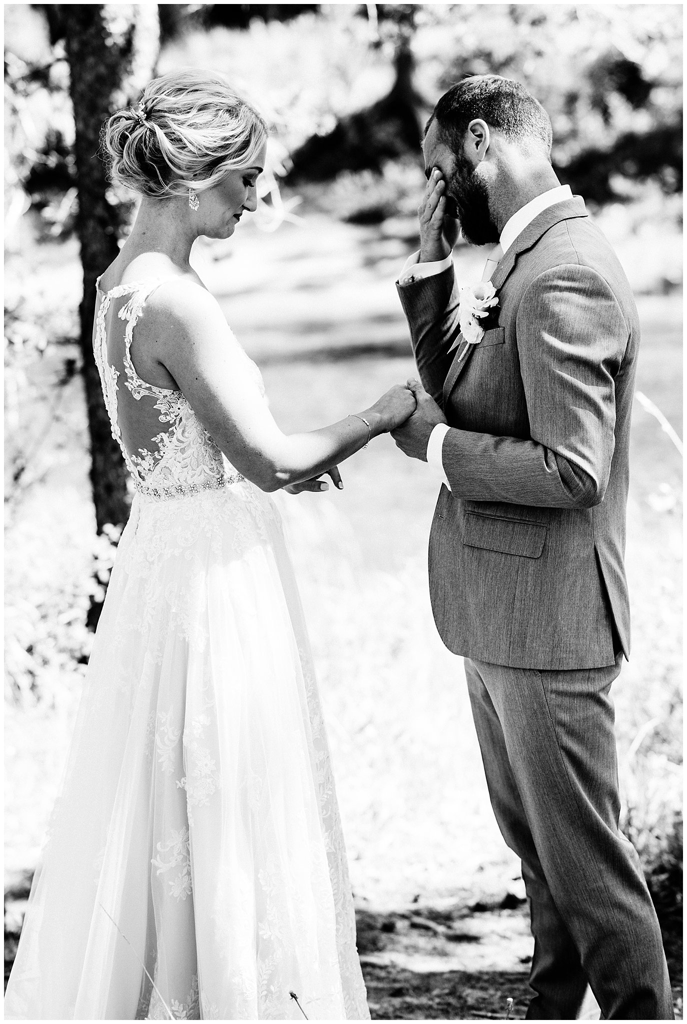 emotional first look by river at Elegant Piney River Ranch wedding by Piney River Ranch wedding photographer Jennie Crate, Photographer