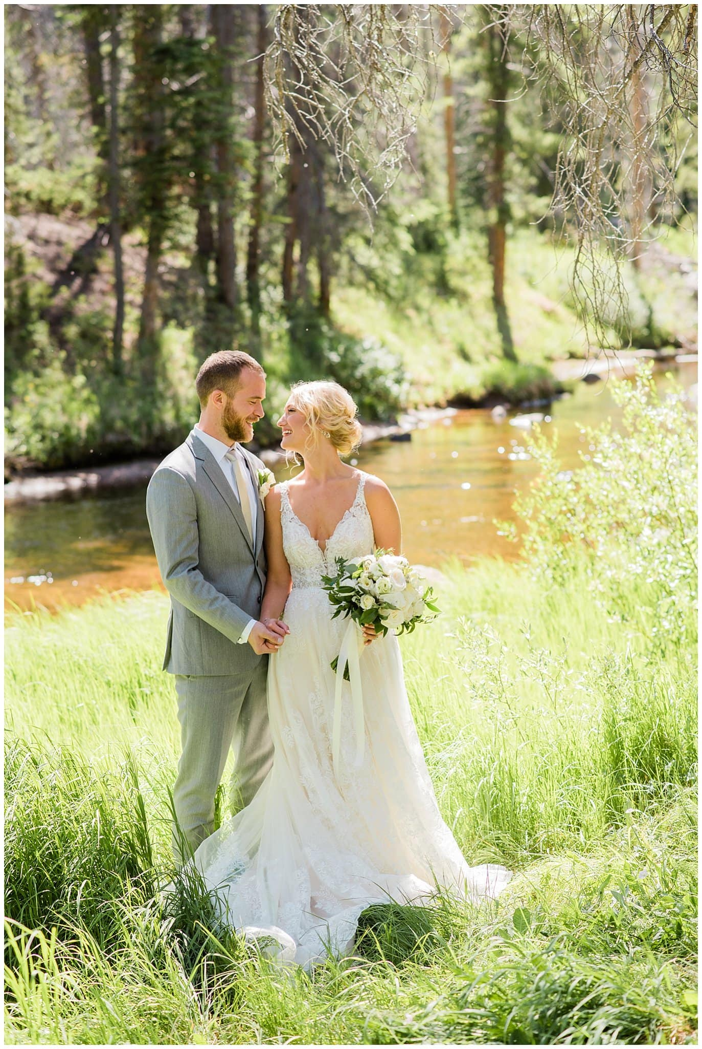 first look by river at at Summer Piney River Ranch wedding by Vail wedding photographer Jennie Crate, Photographer