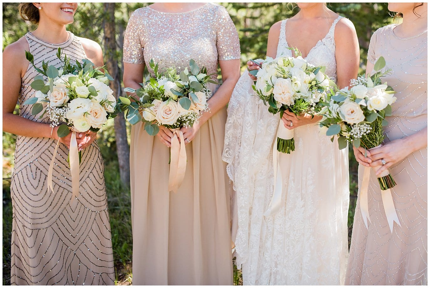 neutral elegant wedding flowers and champagne bridesmaids dresses at Summer Piney River Ranch wedding by Vail wedding photographer Jennie Crate, Photographer