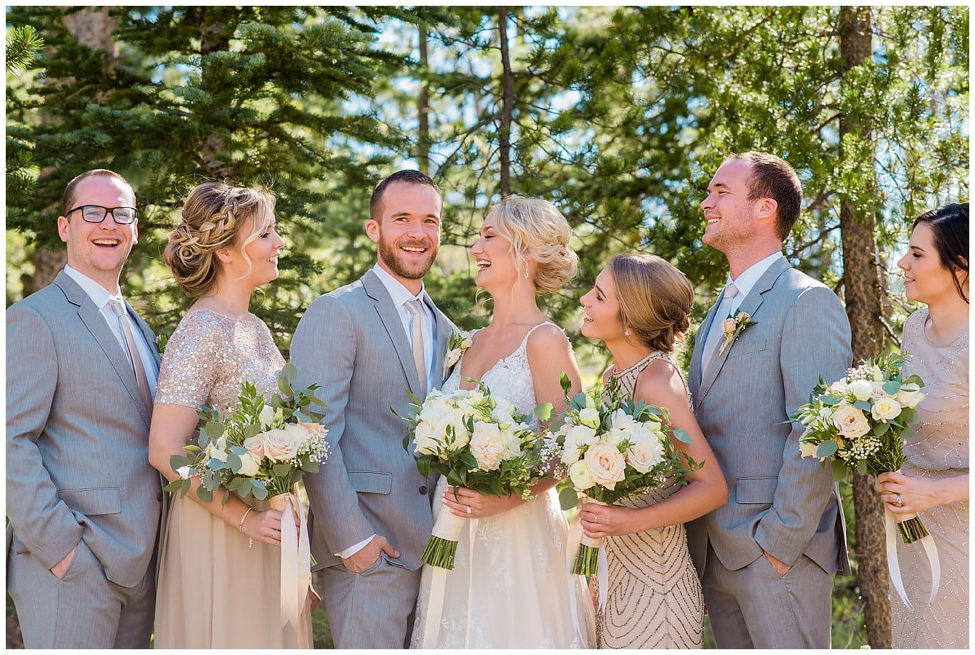 bright elegant wedding party in champagne wedding dresses and grey suites at Elegant Piney River Ranch wedding by Piney River Ranch wedding photographer Jennie Crate, Photographer