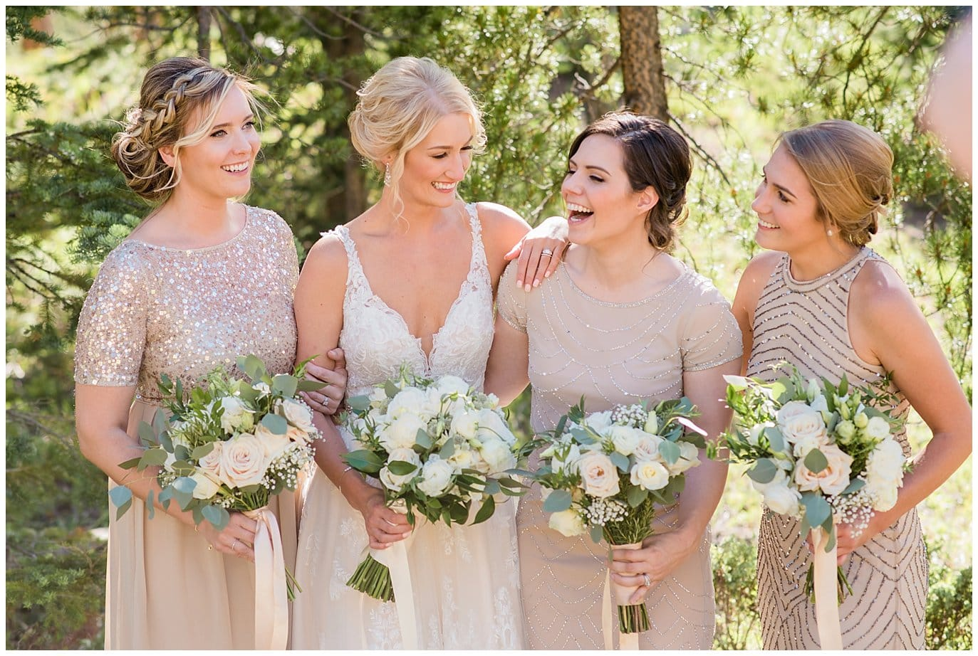 nude and sparkles mismatched bridesmaid dresses at Summer Piney River Ranch wedding by Vail wedding photographer Jennie Crate, Photographer