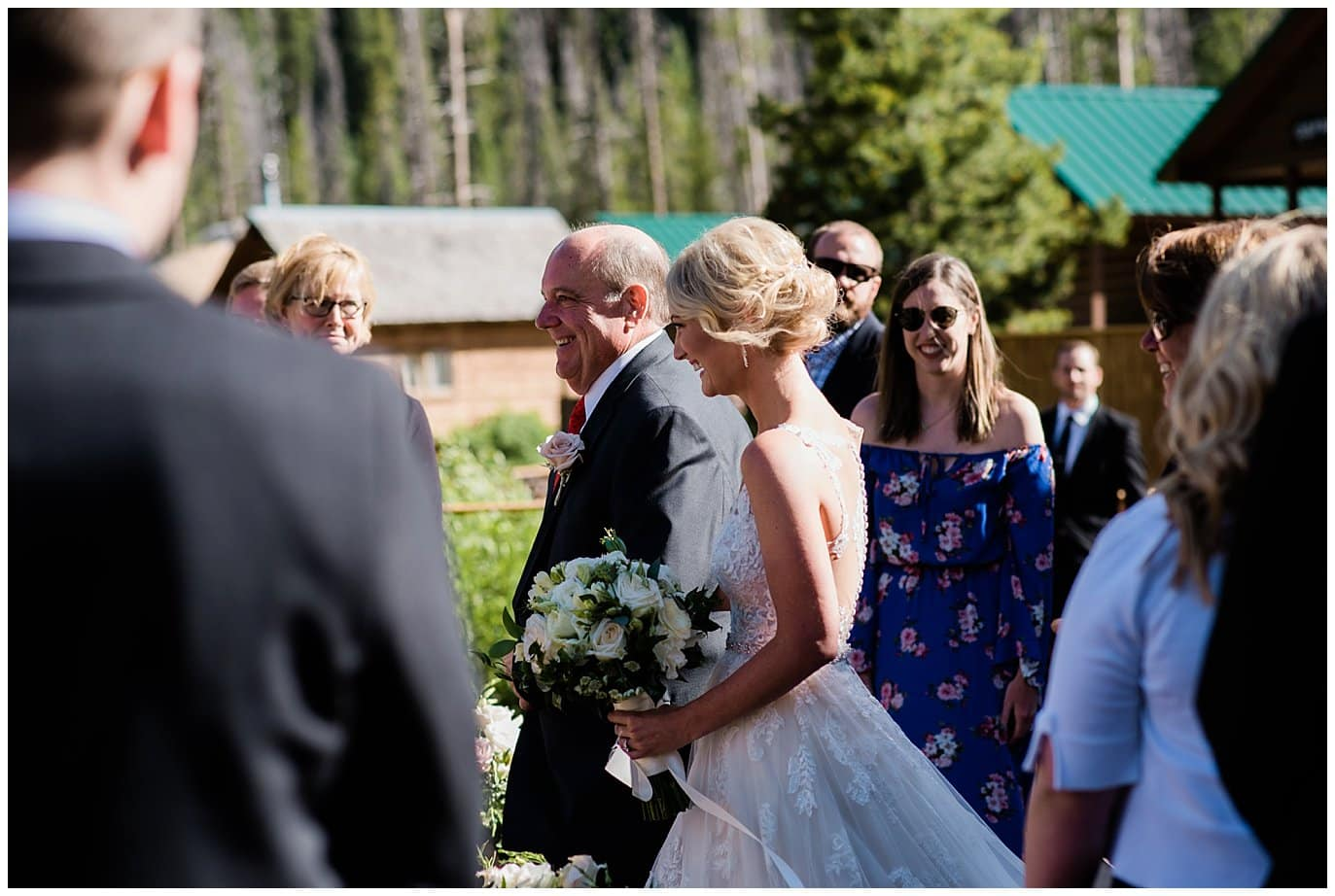 bride walking down aisle at at Piney River Ranch wedding by Beaver wedding photographer Jennie Crate, Photographer