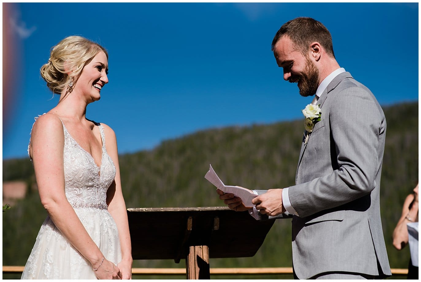 reading vows at intimate lakeside wedding at Piney River Ranch wedding by Beaver Creek wedding photographer Jennie Crate, Photographer
