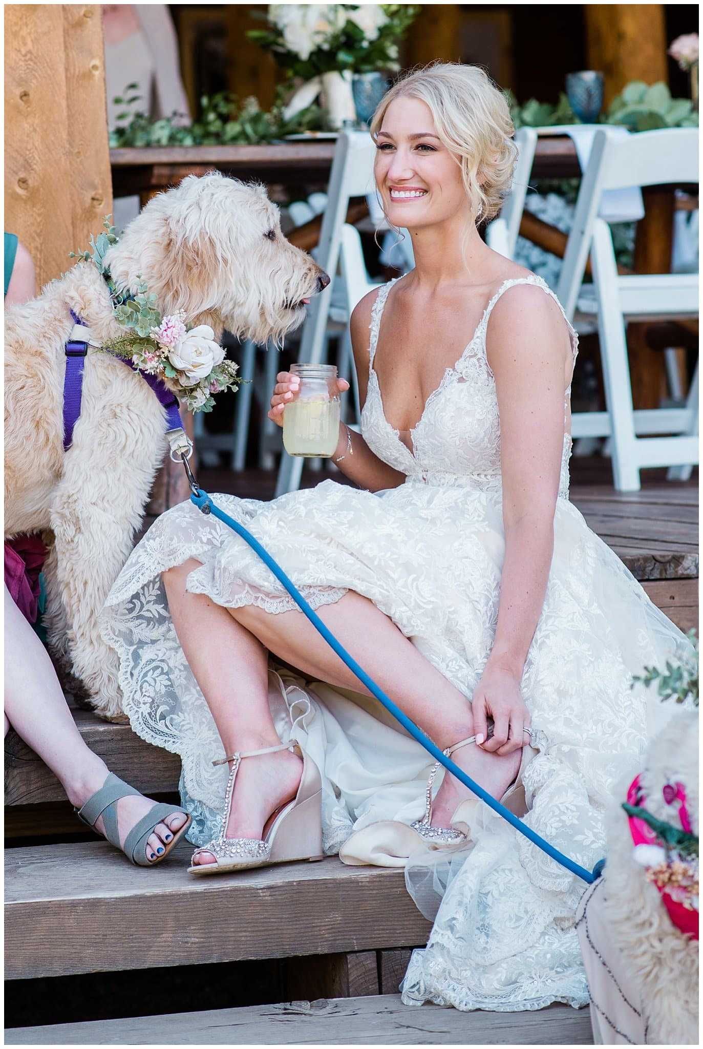 bride and dog relaxing on steps at Piney River Ranch wedding by Beaver Creek wedding photographer Jennie Crate, Photographer