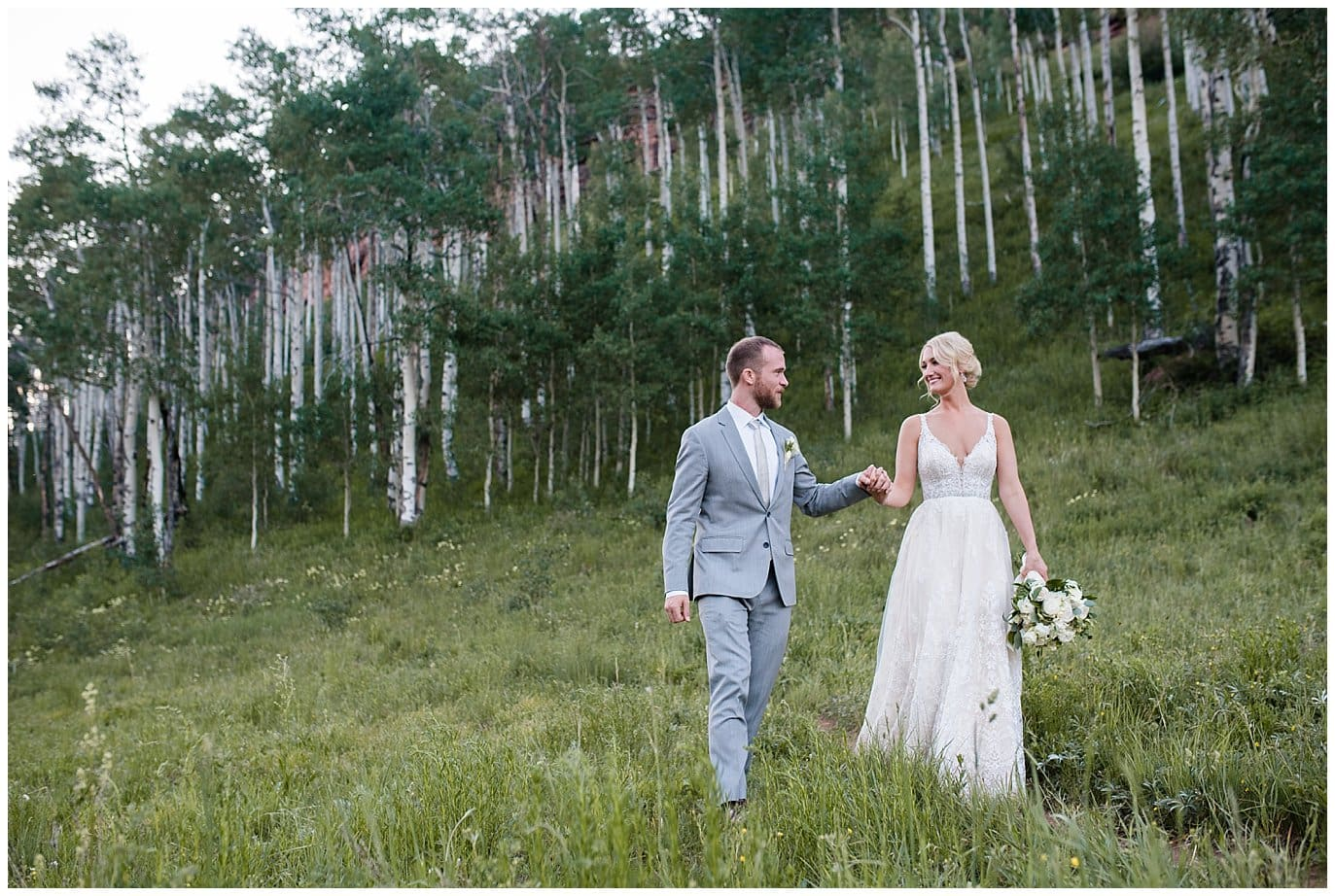 bride and groom in aspens at Piney River Ranch wedding by Beaver Creek wedding photographer Jennie Crate, Photographer