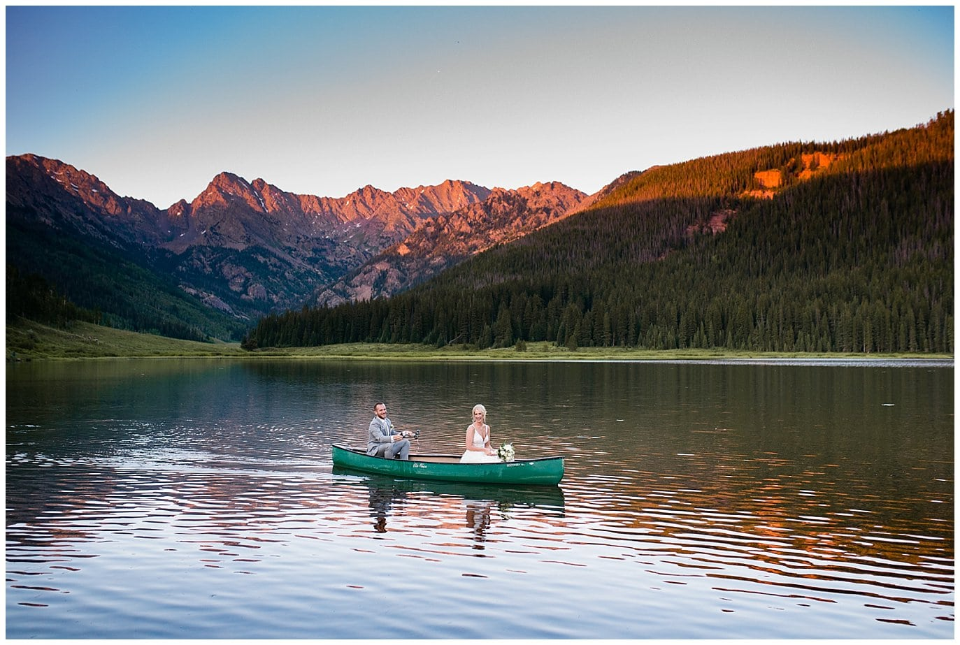 bride and groom on lake in vail colorado at Piney River Ranch wedding by Beaver Creek wedding photographer Jennie Crate, Photographer