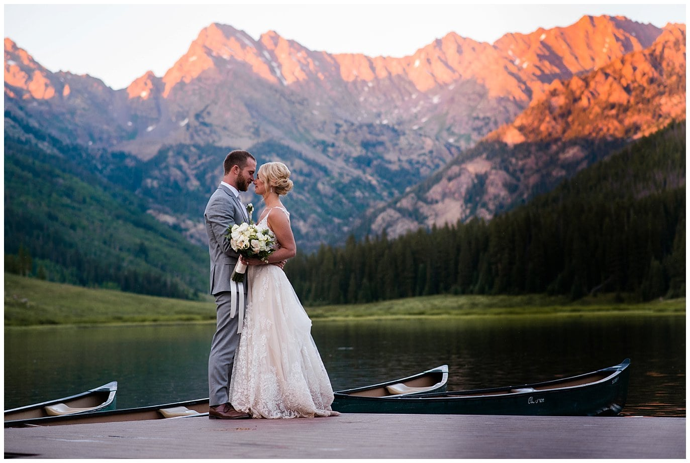 alpenglow sunset portraits on dock at Piney River Ranch wedding by Vail wedding photographer Jennie Crate, Photographer