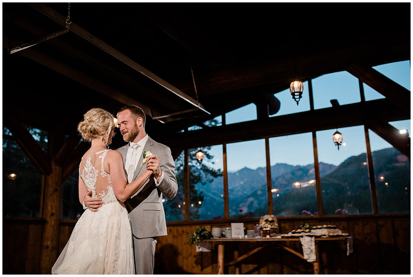 first dance with colorado mountains in background at Piney River Ranch wedding by Aspen wedding photographer Jennie Crate, Photographer
