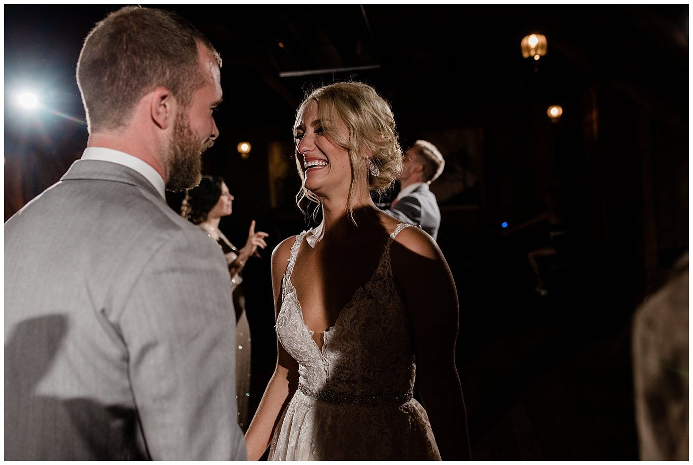 bride and groom laughing at Piney River Ranch wedding by Aspen wedding photographer Jennie Crate, Photographer