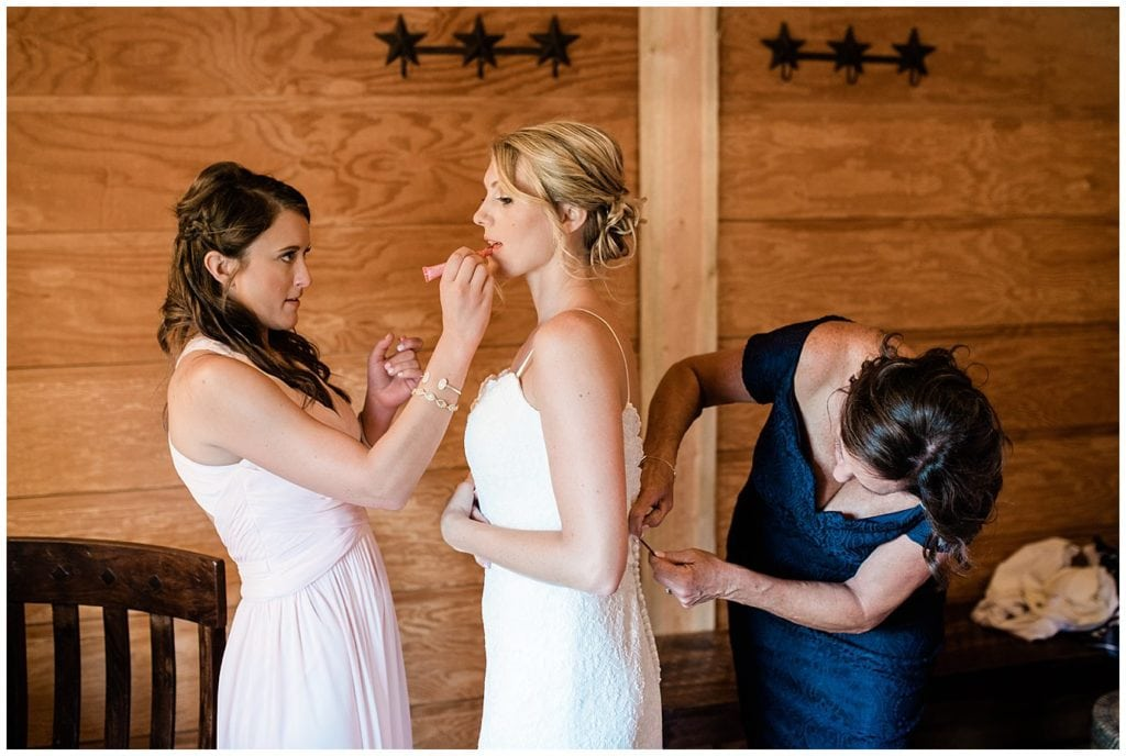 bride getting ready in bridal suite at colorado mountain wedding photo