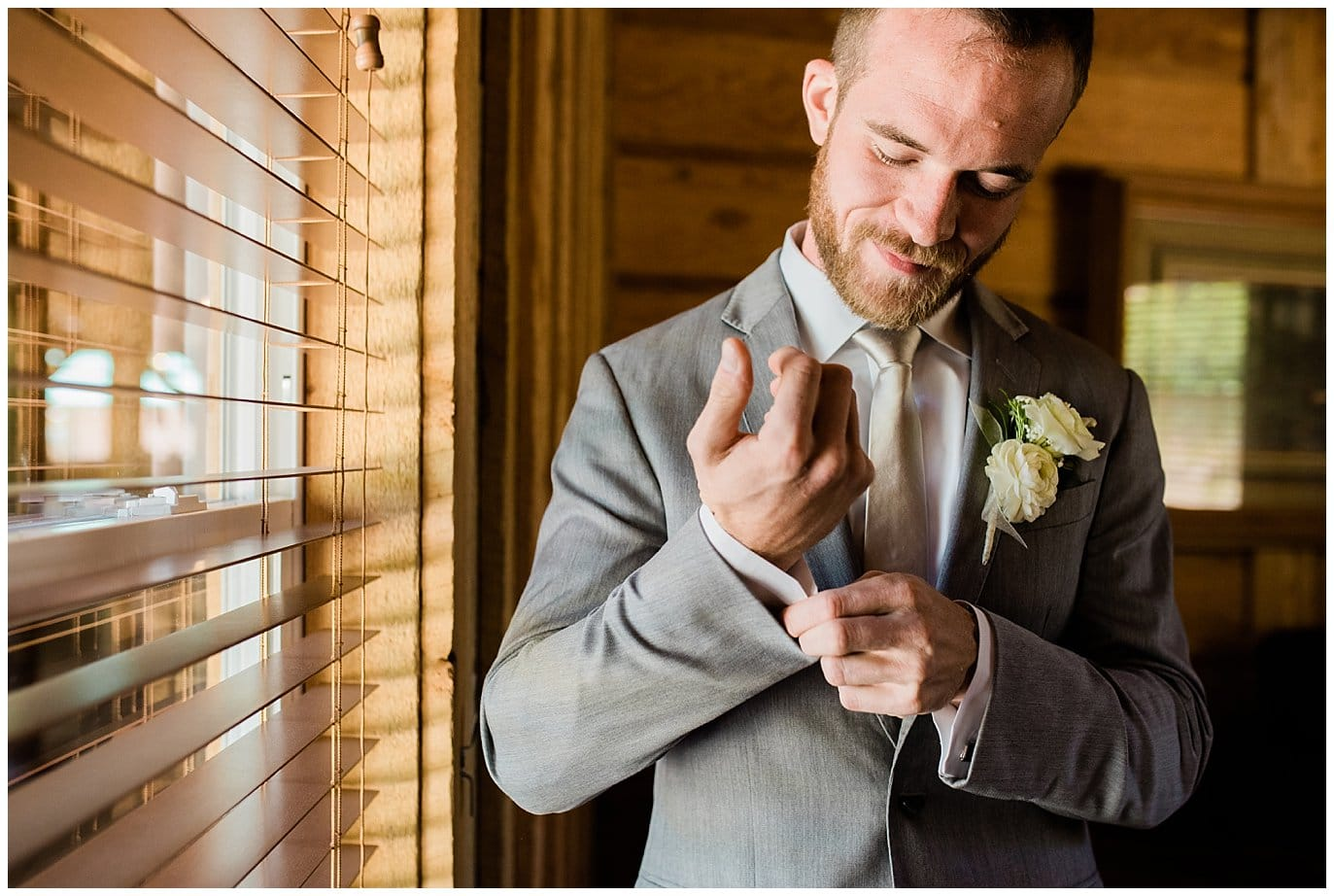 groom getting ready in Groom's Room at Summer Piney River Ranch wedding by Vail wedding photographer Jennie Crate, Photographer