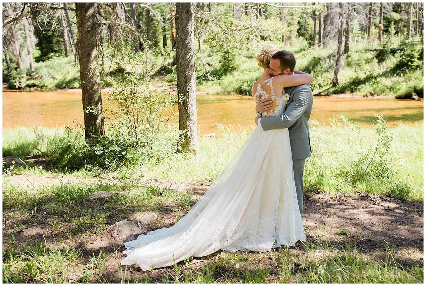 First look by river at Summer Piney River Ranch wedding by Vail wedding photographer Jennie Crate, Photographer