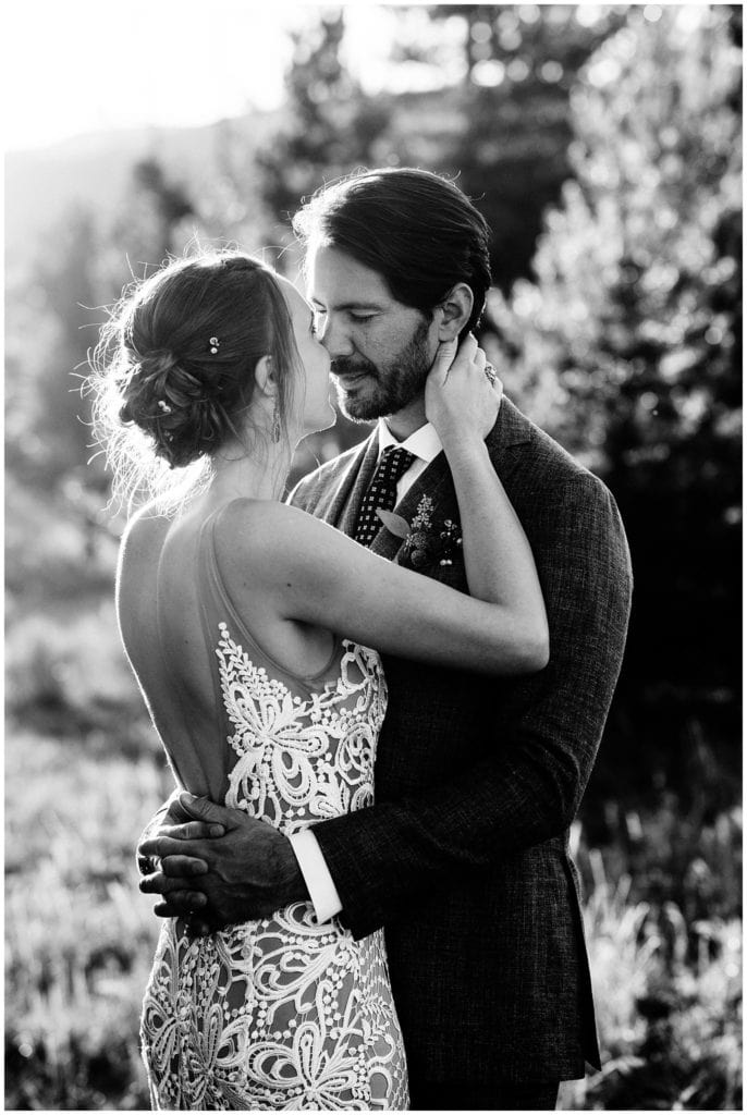 intimate sunset portrait of bride and groom at colorado mountain wedding photo