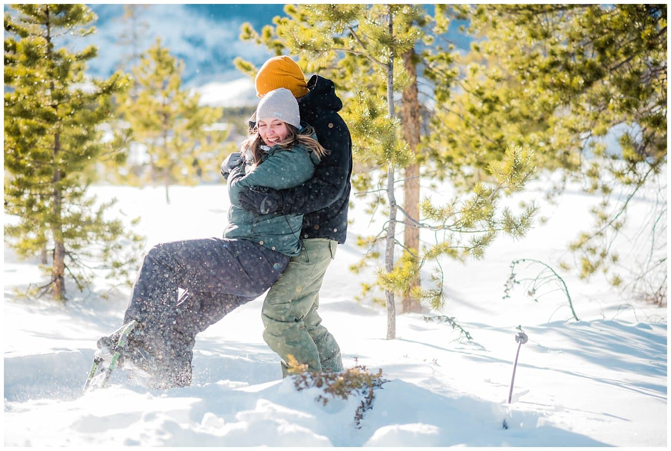 fun in the snow at colorado winter engagement session photo