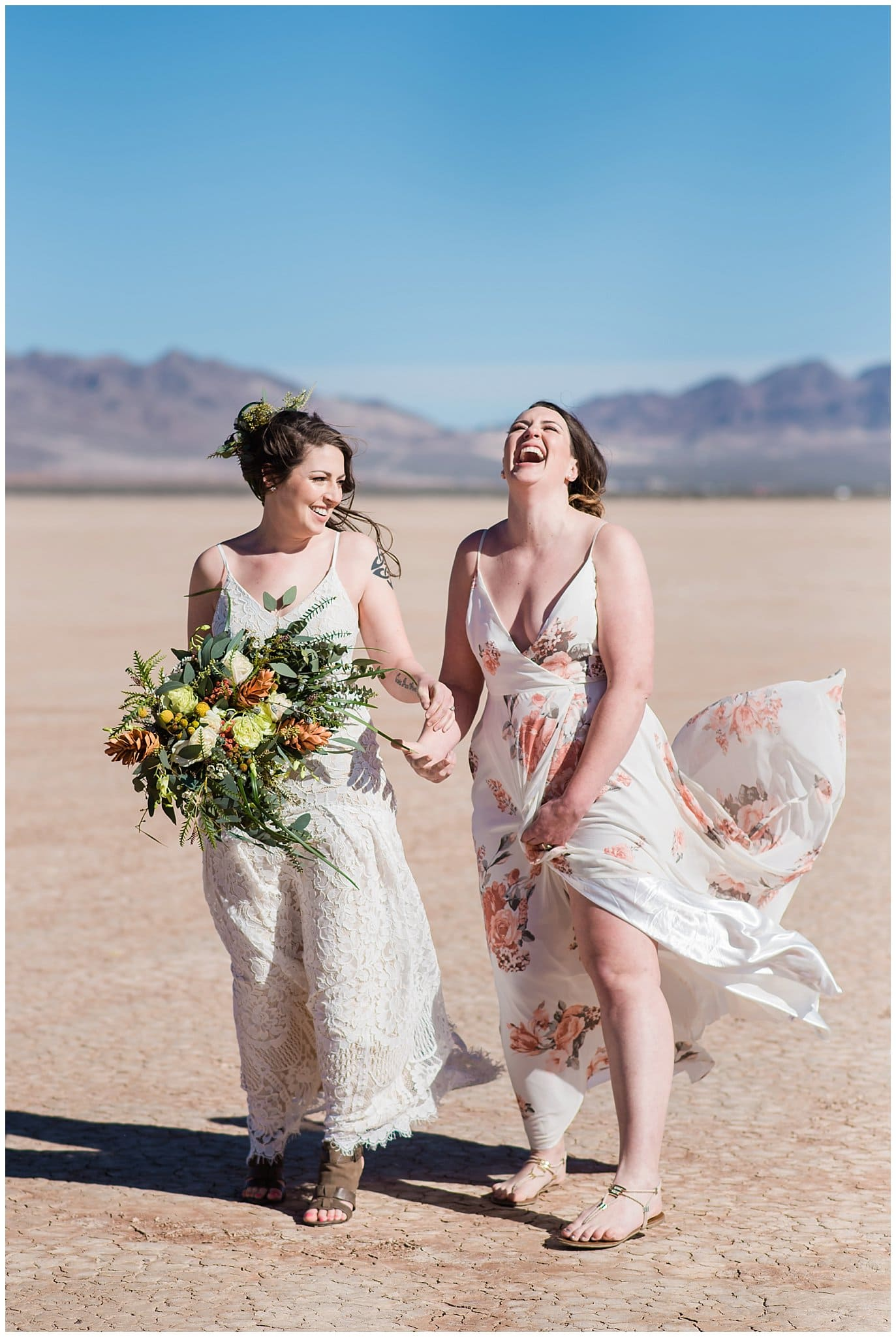 joyful brides laughing at Nevada dry lake beds elopement by Las Vegas elopement photographer Jennie Crate