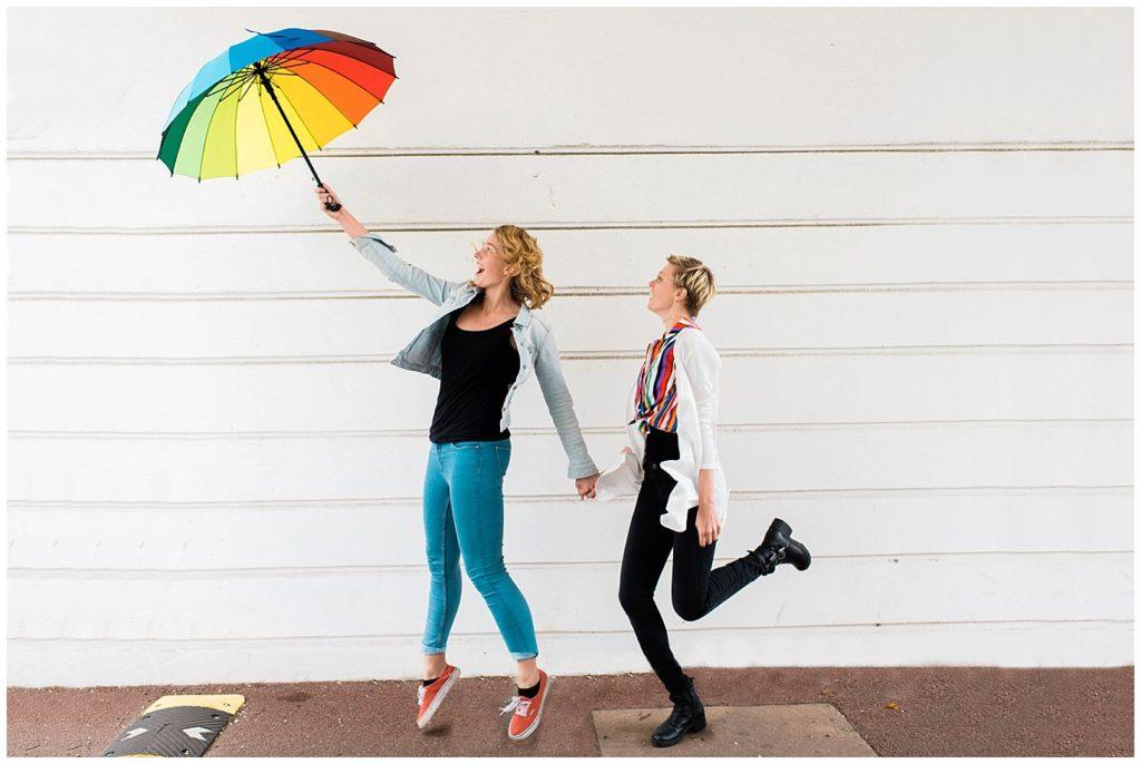 fun umbrella engagement photo