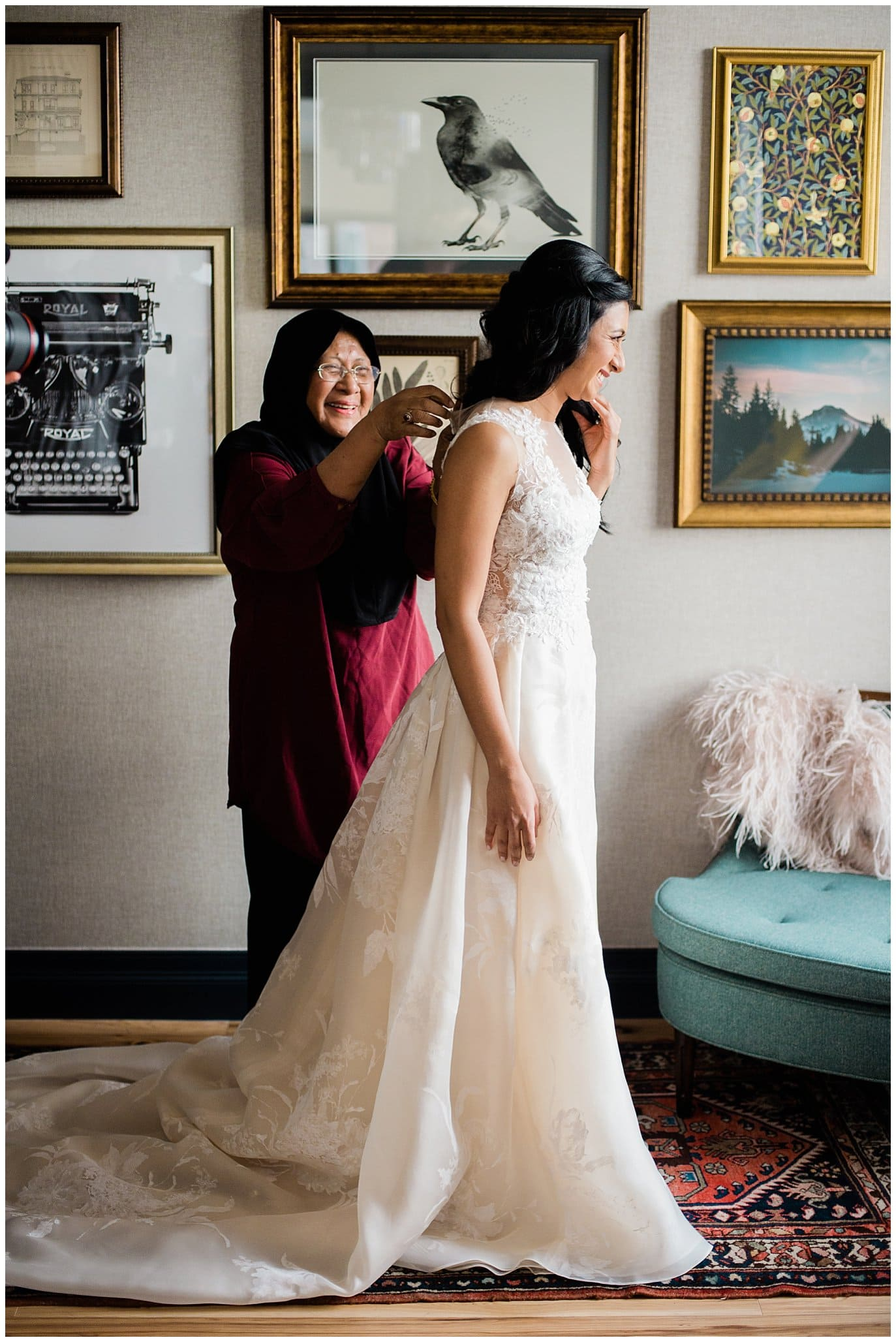 bride getting dresses at Denver city wedding photo by Blanc Wedding Photographer Jennie Crate